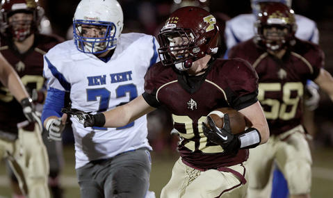 Logan Swartz of Poquoson gets away from the New Kent defense for a big first quarter run Thursday at Poquoson.