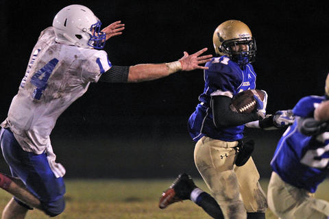 New Kent's Christian Hill-Sanders, left, chases after Smithfield's Jamarie Wrenn during Monday's game at Smithfield.