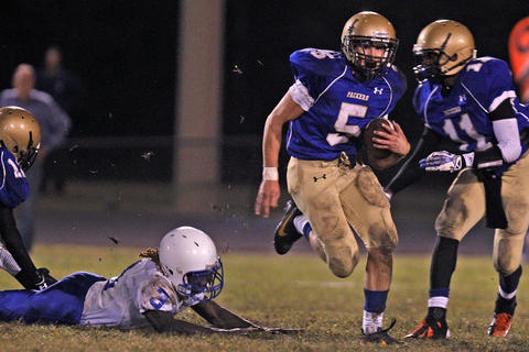 New Kent's Davion Barnes, left, dives and misses the tackle of Smithfield's Ben Jones during Monday's game at Smithfield.