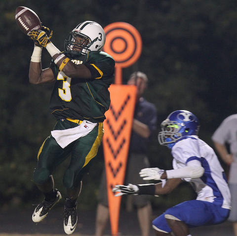 Richard Taylor of Bruton can't hold onto this pass during the second quarter Friday against York.