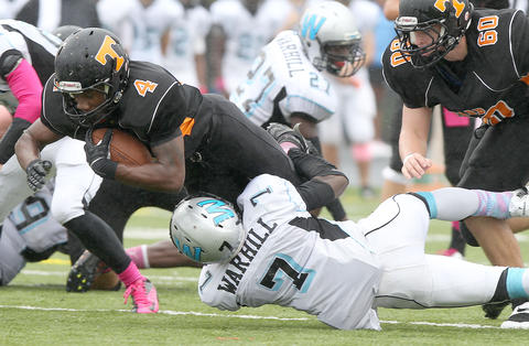 Devonte Dedmon of Warhill can't keep Robert Smith of Tabb out of the endzone during the second quarter Saturday at Bailey Field.