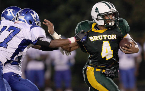 Kapri Doucett of Bruton gets away from Myles Brown of York for a big second quarter run Friday at Bruton.