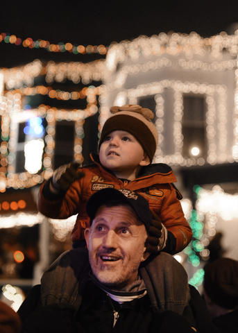 Two-year-old Payton Holbrook, of Baltimore, checks out the lights from his uncle Mike Winthrop's shoulder during the annual lighting on 34th Street.