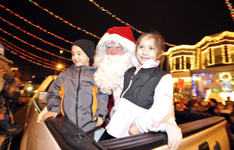 Joseph James (left), 5, and Alexis Keffer (right), 5, of Baltimore help Santa do the countdown to the lighting of 34th Street.