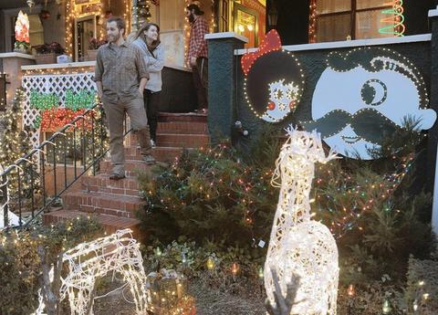 "Shown are Steve Saada and Jessica Baroody on the steps of their ""Natty Boh"" and the ""Utz Girl"" themed Christmas display, at his home on 34th street in Hampden."