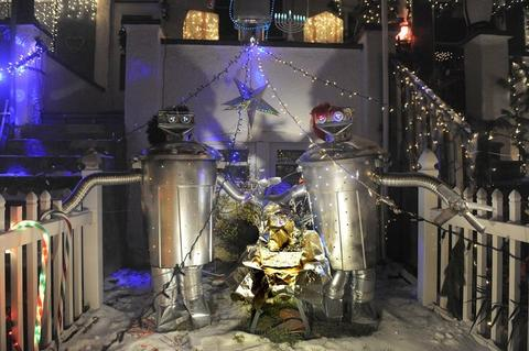 A robot nativity scene at 723 34th Street in Hampden is part of the block's creative holiday light display.