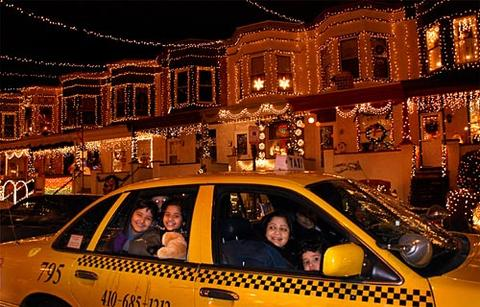 With temperatures in the 30s, spectators stay in their car to watch the Christmas light displays on 34th Street in Hampden.