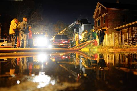 Firefighters work to clean up after a two alarm fire in the 2300 block of West 50th Place on Chicago's South Side.