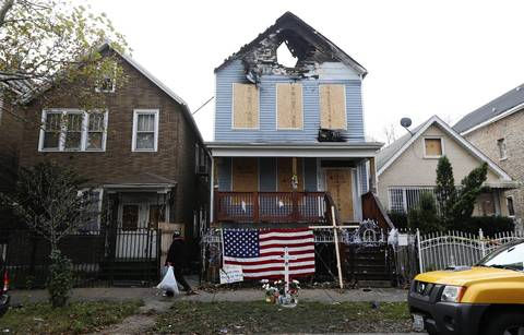 A memorial has been placed at the scene of a fire that killed Chicago firefighter Captain Herbert Johnson at the 2300 block of W. 50th Place in Chicago. An insurance company is suing the City of Chicago and the owners of a two-story building where a Chicago firefighter died last week, asking a judge to stop any future demolition of the site, claiming forensic evidence on the property must be preserved so its experts can complete their investigation.