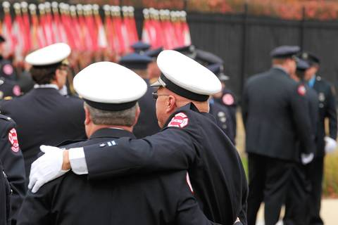 Firefighters gather outside St. Rita of Cascia Shrine Chapel for the funeral of Chicago firefighter Capt. Herbert Johnson.