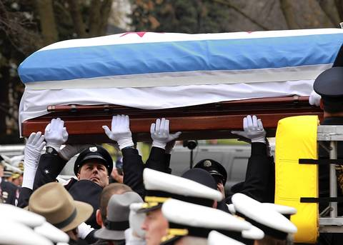 "White-gloved hands handle the casket carrying Chicago firefighter Captain Herbert ""Herbie"" Johnson before his funeral at St. Rita of Cascia Shrine Chapel in Chicago."