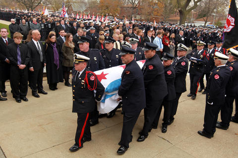 The casket of Chicago firefighter Capt. Herbert Johnson is carried into the church.
