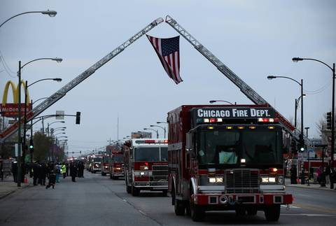 "Fire ladders are raised as a symbol of respect for Chicago fire Captain Herbert ""Herbie"" Johnson, who was killed while fighting a a fire at a South Side home last week."