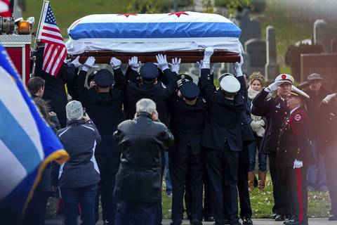 "The casket of Chicago Fire Dept. Capt. Herbert ""Herbie"" Johnson arrives at Mt. Olivet Catholic Cemetery in Chicago for burial."