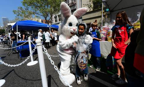 A person dressed as the Easter Bunny embraces a child as people gather at the Los Angeles Mission's Good Friday event on Skid Row in Los Angeles, California. Celebrities and volunteers joined together in giving something back to this community of the homeless, among the largest in the US, who were fed a fully-prepared meal and had the opportunity to be given foot washing and hygiene kits. Foot washing, a symbolic ritual of humbleness and respect derived from Jesus Christ's washing of his disciples feet at the Last Supper, was offered by the Los Angeles Health Center and volunteers.