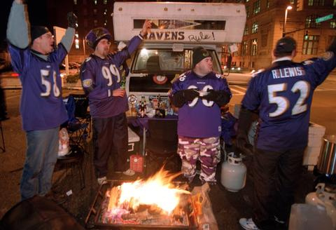 Tailgaiters celebrate the Ravens' first home Monday night game.