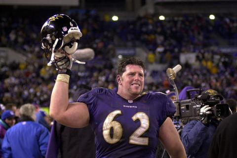 Ravens center Mike Flynn celebrates the win.