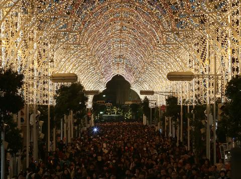 People walk under illuminated shopping street as a part of the 19th Kobe Luminarie on December 5, 2013 in Kobe, Japan. The annual illumination event, which began in 1995 to commemorate the victims of Hanshin Awaji Great Earthquake, will be taken place from December 6 to 17 this year.