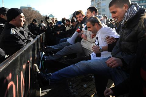 Students kick the fences in front of the National Parliament building during an anti-government students protest in Sofia on December 5, 2013. Hundreds of Bulgarian students in Sofia protested to demand the resignation of the Socialist-backed government and an end to corruption in politics.