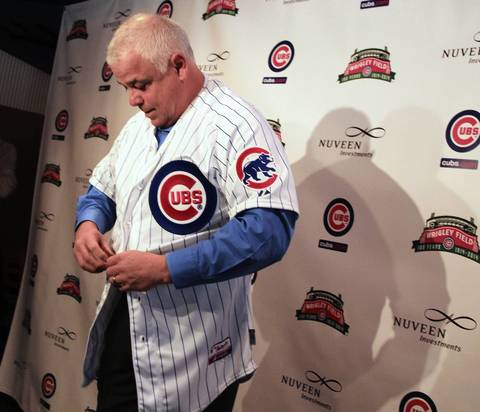 New Cubs manager Rick Renteria tries on his uniform at Wrigley Field.
