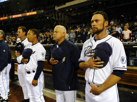 New Cubs manager Rick Renteria stands for the national anthem while serving as Padres bench coach last season.