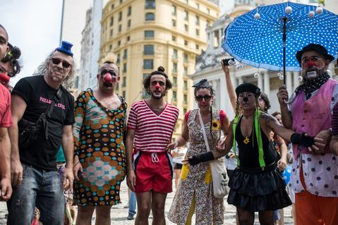 "Clown gather before performing in the ""Anjos do Picadeiro"" annual week-long event in Rio de Janeiro, Brazil, on December 5, 2013. About 100 clowns and street performers turn a street into a theater until December 7."