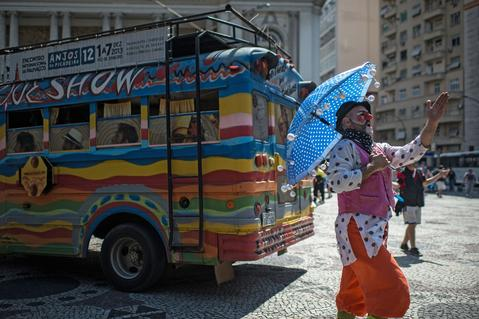 "A clown prepares to perform in the ""Anjos do Picadeiro"" annual week-long event in Rio de Janeiro, Brazil, on December 5, 2013. About 100 clowns and street performers turn a street into a theater until December 7."