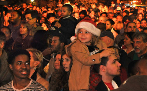 Audience watching the entertainment at the 42nd annual lighting of Baltimore's Washington Monument.