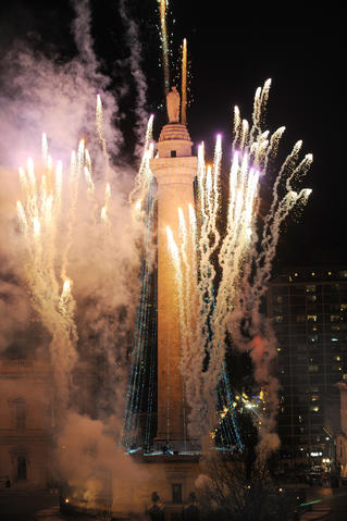 A view of the annual lighting of the Washington Monument from the Park Plaza building on North Charles Street.