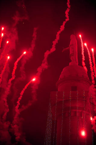 Fireworks dance around Baltimore's Washington Monument in a view from the east.