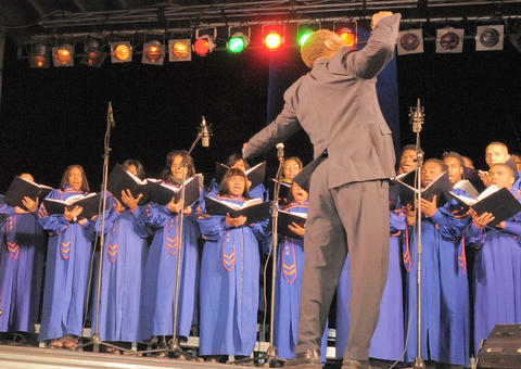 The Morgan State University Choir performs at the lighting of the Washington Monument.