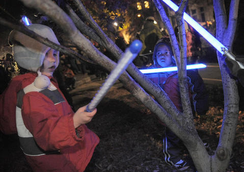 Amelia Mogul, 4, from Bolton Hill, and Cameren Matthews, 3, from Baltimore, play with toy light sabers at the 39th annual lighting of the Washington Monument.