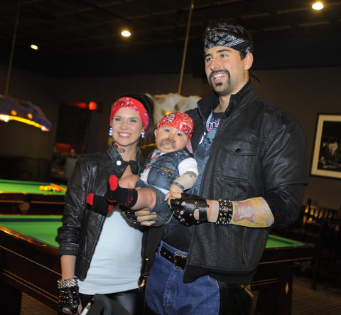 Ravens tight end Dennis Pitta and wife, Mataya, are with son Decker, 6-months old at the 14th Annual Goodwill Gridiron Halloween Party on Monday.