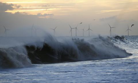 Waves crash onto the beach after a storm surge in Hemsby, eastern England December 6, 2013.