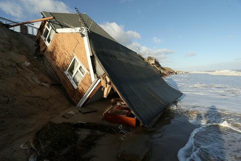 The scene where properties have fallen into the sea due to the cliff collapsing on December 6, 2013 in Hemsby, England. Thousands of people were evacuated from their homes as a deadly winter storm and the highest tidal surge in 60 years hit east coast towns overnight, causing flooding and damage in many areas.