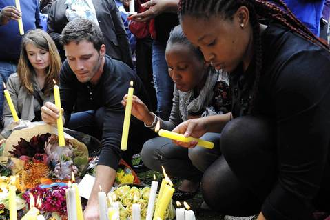 Mourners place candles outside the home of South Africa's former President Nelson Mandela in Johannesburg.