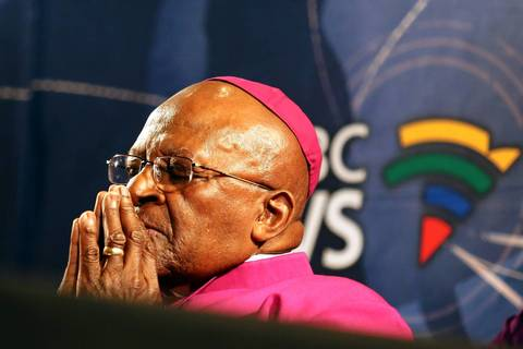South Africa's Archbishop Desmond Tutu pauses for a moment during a media briefing in Cape Town, a day after the death of his friend and former South African President Nelson Mandela.