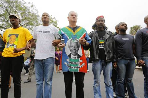 South Africans mourn outside the house of the late South African president Nelson Mandela in Johannesburg, South Africa.