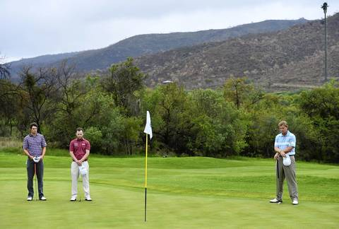 Peter Uihlein, of the United States, Branden Grace of South Africa and Ernie Els of South Africa observes a minute of silence for South African President Nelson Mandela prior to the continuation of the weather delayed first round of the Nedbank Golf Challenge at Gary Player CC in Sun City, South Africa.