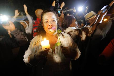 Mourners sing songs outside the house of the late former South African President Nelson Mandela in Johannesburg, South Africa, in the early hours of Dec. 6, 2013. Nobel Peace Prize winner Nelson Mandela has died aged 95, in Johannesburg, South Africa, on Dec. 5, 2013.