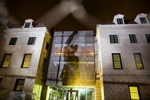 A shadow from a statue of the late former South African President Nelson Mandela is cast on the South African Embassy, currently under construction, in Washington DC. Mandela has died at age 95 at his home in Johannesburg, South Africa, on Dec. 5, 2013.