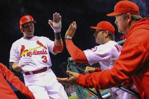 Carlos Beltran of the St. Louis Cardinals is congratulated by manager Mike Matheny and pitching coach Derek Lilliquist.