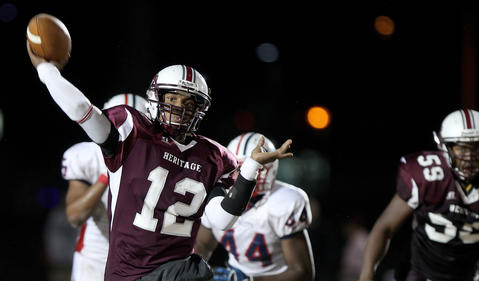 Jeremiah Boyd of Heritage throws a third quarter touchdown against Denbigh during their playoff game Friaday at Todd.