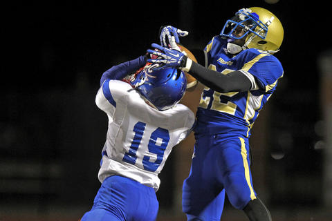 Phoebus' Trevione Powell, right, intercepts a ball intended for Caroline's Pankey Aason during Friday's game at Darling Stadium.