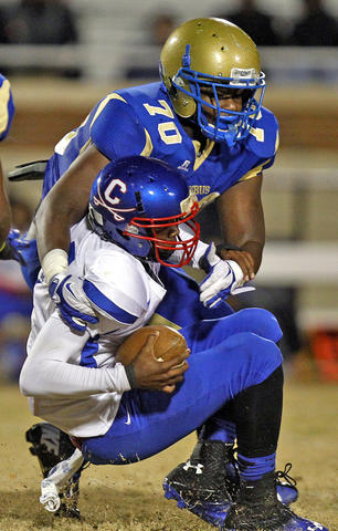 Phoebus' Harry Lewis sacks Caroline quarterback Rasharrd Harris during Friday's game at Darling Stadium.