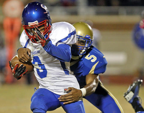 Phoebus' Antonio Brown, right, chases down and tackles Caroline's Jaquan Monroe during Friday's game at Darling Stadium.