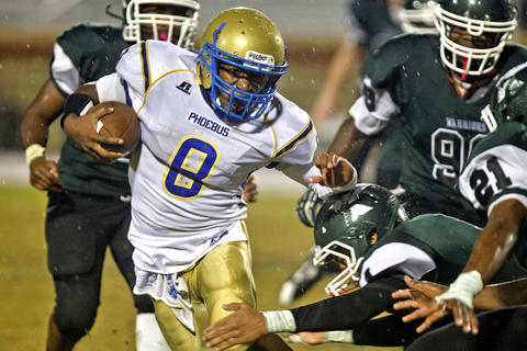 Phoebus' Joe Addison runs away from Kecoughtan's Kashawn Lynch, right, and other defenders during Friday's game at Darling Stadium.