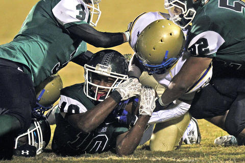 Phoebus' Jacques Moore-Roberts, right, battles for a fumble with Kecoughtan's Elijah White, center, during Friday's game at Darling Stadium.