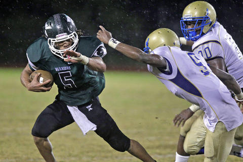 Phoebus' Haasan Price, right, chases after Kecoughtan's Ja'cione Fugate, left, during Friday's game at Darling Stadium.