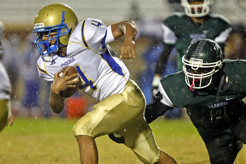 Phoebus' Jomari Becnel, left, runs away from Kecoughtan's Gregory Bennett, right, during Friday's game at Darling Stadium.